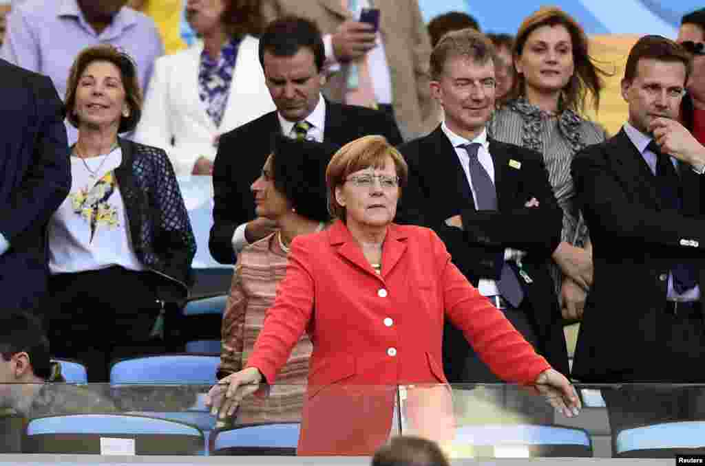 German Changellor Angela Merkel attends the 2014 World Cup final between Germany and Argentina at the Maracana stadium in Rio de Janeiro, July 13, 2014.