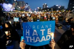 FILE - South Korean protesters stage a rally to oppose a plan to deploy the advanced U.S. missile defense system called Terminal High-Altitude Area Defense, or THAAD, near U.S. Embassy in Seoul, South Korea, April 29, 2017.