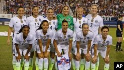 The US team poses prior to their match against Germany in a women's soccer game in the SheBelieves Cup, Wednesday, March 9, 2016, in Boca Raton, Fla. (AP Photo/Joel Auerbach)