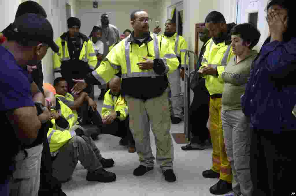 Team leader Joey Rivera gives a speech while the team waits to assist in the aftermath of Hurricane Maria in Humacao, Puerto Rico, Sept. 20, 2017.