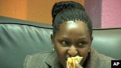 A woman eats fast food at a restaurant in Kenya