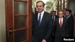 Newly appointed Greek Prime Minister Antonis Samaras arrives for the first cabinet meeting of his government at the parliament in Athens, June 21, 2012.
