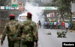 "FILE - Supporters of Kenya's opposition Coalition for Reforms and Democracy (CORD) run after riot police fired tear gas before their ""Saba Saba Day"" rally in July 2014 in Nairobi."