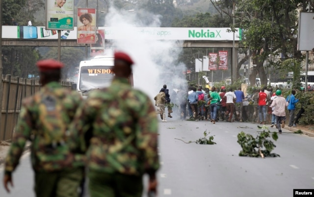 "Supporters of Kenya's opposition Coalition for Reforms and Democracy (CORD) run after riot police fired tear gas before their ""Saba Saba Day"" rally at the Uhuru park grounds in the capital Nairobi, July 7, 2014."