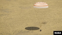 The Soyuz TMA-03M spacecraft lands with three members of Expedition 31 from the International Space Station in a remote area near the town of Zhezkazgan, Kazakhstan, July 1, 2012.