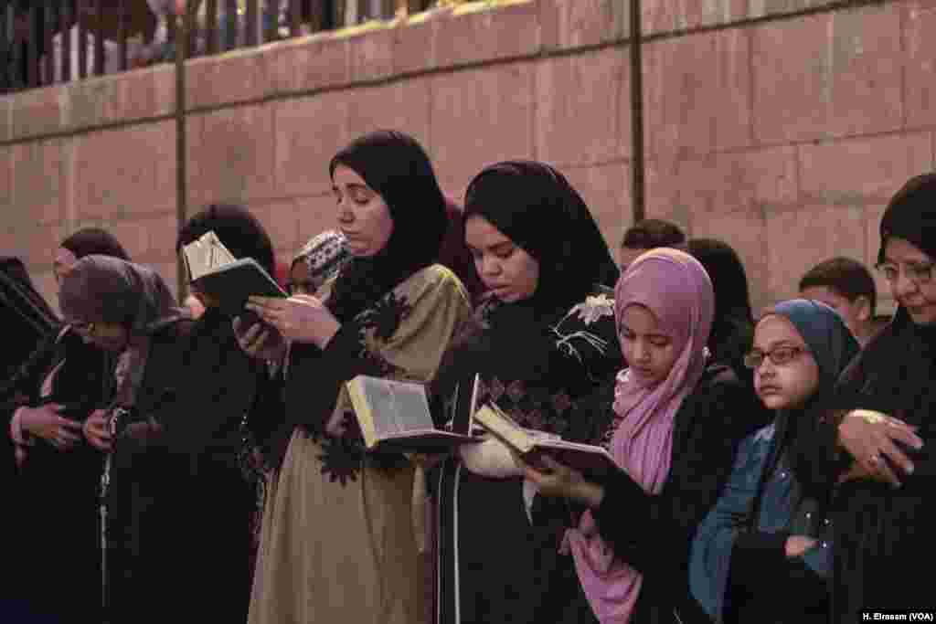 Muslims attend the prayers and some follow the Imam's recitation in their Qurans in Amr Ibn al-As mosque, in old Cairo, Egypt, May 31, 2019.
