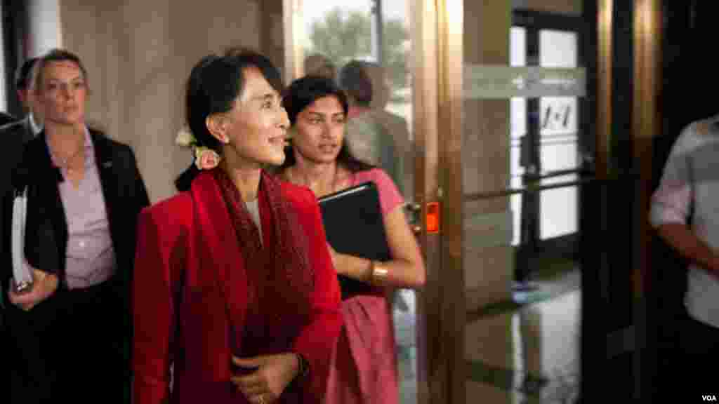 Aung San Suu Kyi smiles as she enters VOA headquarters during her first visit to the U.S. since being released from nearly two decades of house arrest.