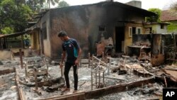 Hiện trường sau vụ tấn công ở Aluthgama, phía nam thủ đô Colombo, ngày 16/6/2014.