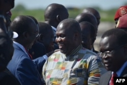 FILE - Rebel leader Riek Machar (C) meets with his supporters after landing at Juba international airport on April 26, 2016.