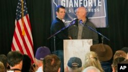 Republican Greg Gianforte (right) welcomes Donald Trump Jr. on to the stage at a rally in East Helena, Mont., May 11, 2017. Trump Jr. urged voters to support Gianforte in the May 25 special U.S. House election to fill the seat of Ryan Zinke, now President Trump's Interior secretary.