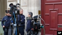 French police officers stand outside the residence of Kim Kardashian West in Paris Monday, Oct. 3, 2016. Kim Kardashian West was unharmed after being robbed at gunpoint of more than $10 million worth of jewelry inside a private Paris residence Sunday nigh