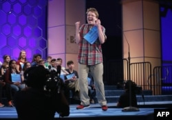 FILE - Jacob Daniel Williamson of Cape Coral, Florida, reacts after he correctly spelled his word during round five of the 2014 Scripps National Spelling Bee competition, May 29, 2014, in National Harbor, Md.