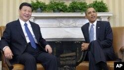 지난 2월 14일 백악관에서 만난 바락 오바마 미 대통령(오른쪽)과 시진핑 중국 공산당 총서기. 당시 시진핑은 중국 국가 부주석. (자료사진)