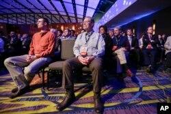 Audience members listen to the Republican presidential primary debate in Des Moines, Iowa, Jan. 28, 2016.