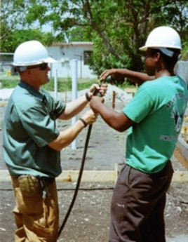 Student Daniel Norzea (right) and instructor Tim Sachse work together at the construction site.