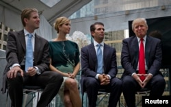 FILE - Donald Trump (R) along with his children Eric (L), Ivanka (2nd L) and Donald Jr. attend a ceremony announcing a new hotel and condominium complex in Vancouver, British Columbia, June 19, 2013.