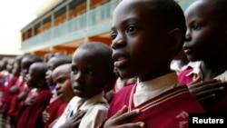 FILE - Students sing during morning assembly at Kyamusansala Primary School in Masaka, Uganda, March 24, 2009.
