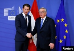 Austria's Chancellor Sebastian Kurz poses with European Commission President Jean-Claude Juncker ahead of a meeting in Brussels, Belgium, Dec. 19, 2017.