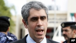 Samer Muscati, a researcher with Human Rights Watch, speaks to Reuters about the conviction of five political activists outside the federal supreme court in Abu Dhabi, November 27, 2011.