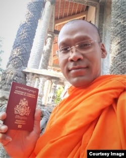 Venerable Seun Ty showed his passport after the Vietnamese authority returned it back to him, in Soc Trang province, Vietnam, Feb. 14, 2020.