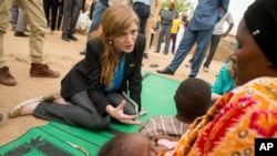 US Ambassador to the United Nations Samantha Power meets with a woman and her children who fled to Mokolo, Cameroon, April 18, 2016, to escape Boko Haram.