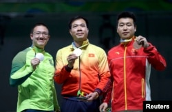 (L-R) Felipe Wu (BRA) of Brazil, Hoang Xuan Vinh (VIE) of Vietnam and Pang Wei (CHN) of China (PRC) pose with their medals.