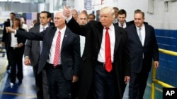President-elect Donald Trump and Vice President-elect Mike Pence wave as they visit to Carrier factory, Dec. 1, 2016, in Indianapolis, Ind.