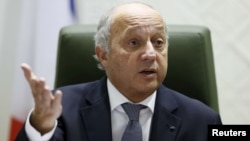 FILE - French Foreign Minister Laurent Fabius gestures as he speaks during a news conference, Jan. 19, 2016.