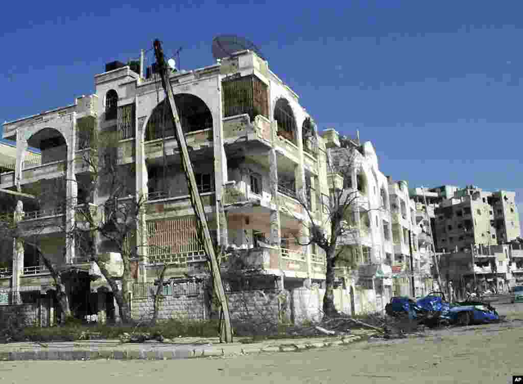 Damaged cars and houses are seen in the Inshaat district of Homs, Syria, in this handout picture received March 9, 2012. (Reuters)