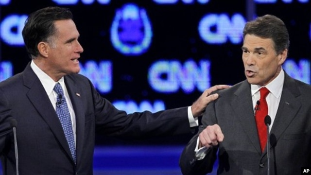 Republican presidential candidate former Massachusetts Gov. Mitt Romney, left, and Texas Gov. Rick Perry speak during a Republican presidential debate October 18, 2011, in Las Vegas.