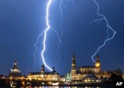 Lightning strikes across the sky in Dresden, Germany, Monday, June 10, 2019. (Robert Michael/dpa via AP)
