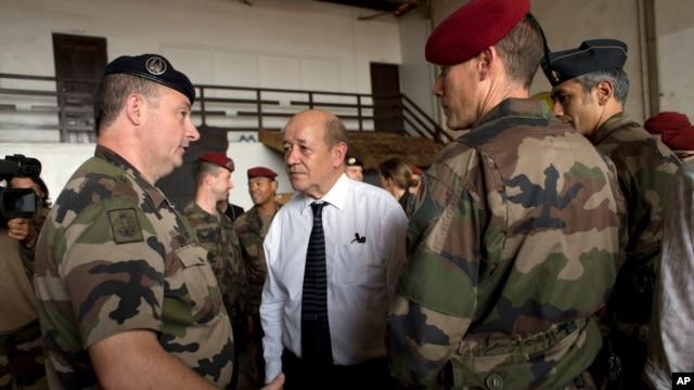 The U.S. has approved $10 million to help France fight terrorism in West Africa. French Defense Minister Jean-Yves Le Drian is shown talking with French soldiers in this file photo taken in nearby Central African Republic on Jan. 2, 2014.