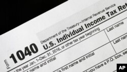 FILE - A 1040 tax form on display in New York, Jan. 10, 2017.