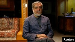 Afghan presidential candidate and former foreign minister Abdullah Abdullah speaks during an interview in Kabul, April 9, 2014.