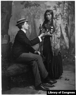 "A woman reads a man's fortune in his palm. These types of psychics are called ""palm reader."" (Library of Congress Photo)"