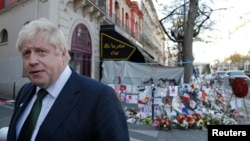 London Mayor Boris Johnson leaves after placing flowers at the Bataclan concert hall to pay tribute to the shooting victims in Paris, France, Dec. 3, 2015. Johnson said on Jan. 5, 2016, that a small child shown threatening non-Muslims in a grisly Islamic State video should be taken from his parents if the family ever returns to Britain.