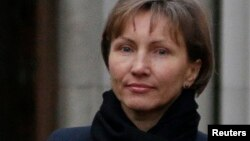 Marina Litvinenko leaves London's High Court after testifying during an inquiry into the 2006 murder of her husband, KGB agent Alexander Litvinenko, on Feb. 2, 2015.