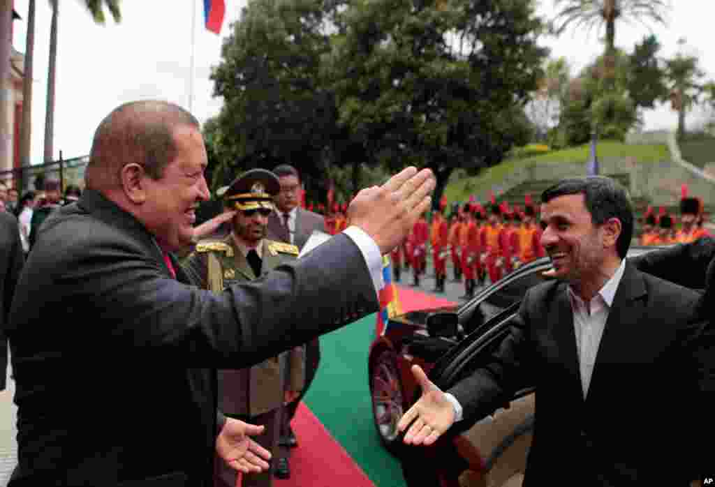 Mr. Ahmadinejad is welcomed by Venezuela's President Hugo Chavez at Miraflores Palace in Caracas on January 9, 2012. (Reuters)