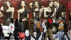 Shoppers walk in front of a bus with a huge clothing advertisement on Black Friday. The Friday after the Thanksgiving holiday is one of the biggest shopping days of the year