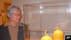 Ceramic artist Cliff Lee - pictured with his porcelain 'Prickly Melon' featuring his signature yellow glaze - combines his background as a neurosurgeon with his passion for clay to create exquisite objects inspired by his Chinese heritage.