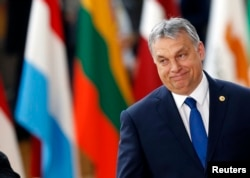 FILE - Hungarian Prime Minister Viktor Orban arrives at the EU summit in Brussels, Belgium, March 9, 2017.