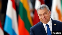 FILE - Hungarian Prime Minister Viktor Orban arrives at the EU summit in Brussels, Belgium, March 9, 2017. Since his return to power in 2010, his allies have greatly increased their ownership of newspapers, broadcasters and online media, turning the outlets into unquestioning supporters of the government.