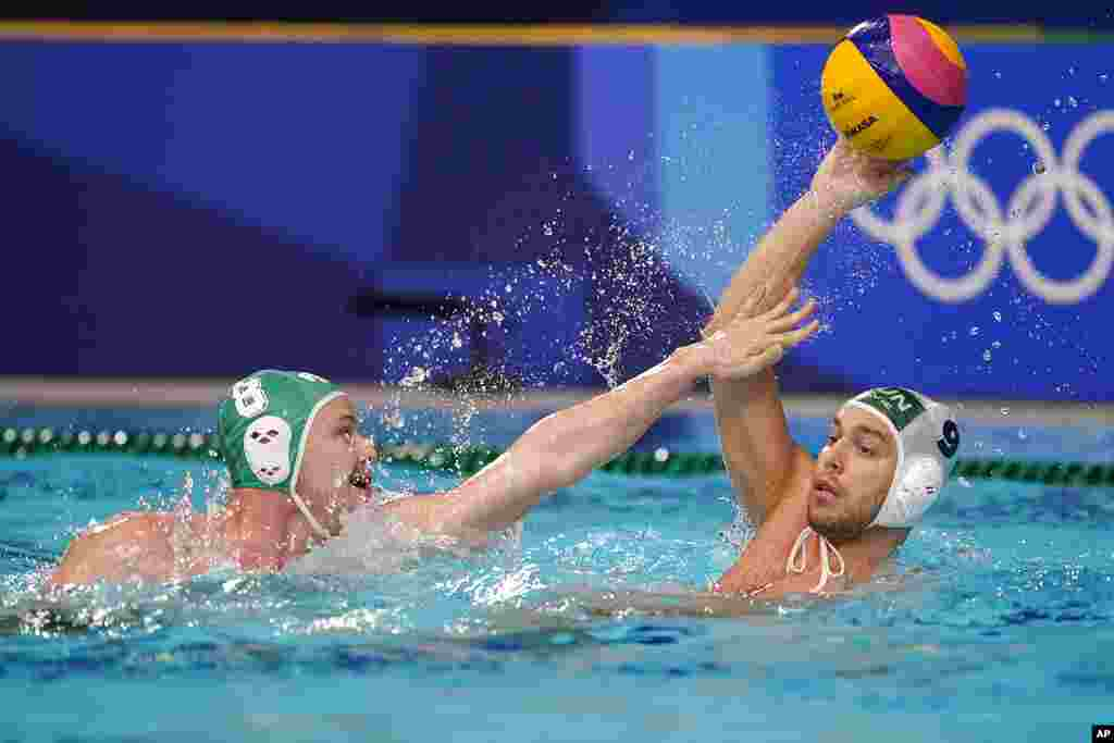 South Africa's Nicholas Rodda (8) defends against Hungary's Balazs Erdelyi (9) during a preliminary round men's water polo match at the 2020 Summer Olympics, Thursday, July 29, 2021, in Tokyo, Japan. (AP Photo/Mark Humphrey)
