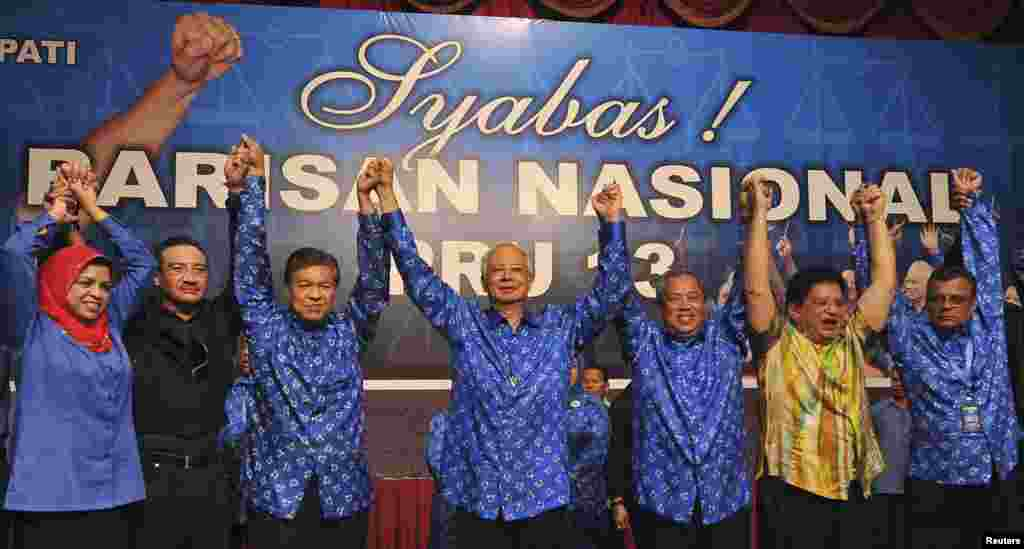 Malaysia's Prime Minister Najib Razak celebrates after winning elections at his party headquarters in Kuala Lumpur, Malaysia, early May 6, 2013.