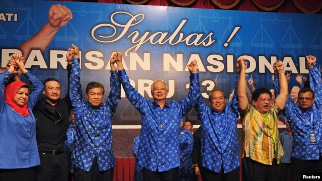 Malaysia's Prime Minister Najib Razak celebrates after winning the elections at his party headquarters in Kuala Lumpur, Malaysia, early May 6, 2013.