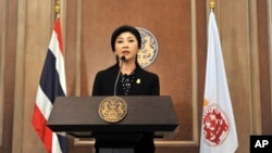 Thai Prime Minister Yingluck Shinawatra speaks at a news conference after a cabinet meeting at an Air Force base in Bangkok, Thailand, Dec. 25, 2013.