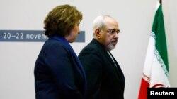 欧盟外交政策负责人阿什顿与伊朗外长扎里夫抵达日内万谈判地点