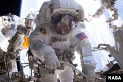 NASA astronaut Peggy Whitson on a spacewalk in March 2017. She holds the record for most spacewalks by a female and now the most days in orbit by an American.