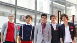 "Members of British-Irish band One Direction pose after performing on NBC's ""Today"" show in New York March 12, 2012."
