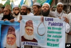 FILE - Pakistanis rally to condemn the execution of Bangladesh's Jamaat-e-Islami party chief Motiur Rahman Nizami, May 11, 2016, in Peshawar, Pakistan. Nizami was executed for crimes committed during Bangladesh's independence war against Pakistan.